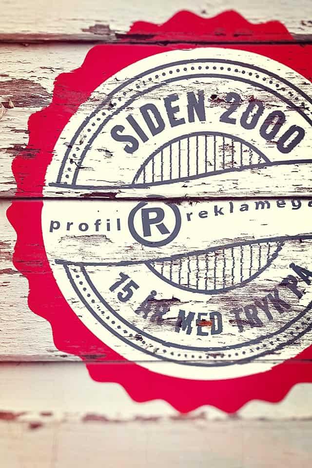 15 års jubilæums logo for Profil Reklamegaver